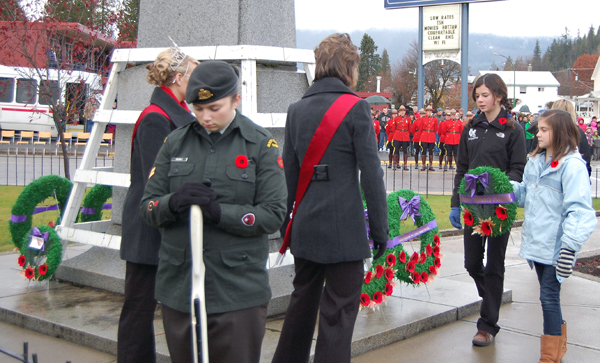 Arrow Heights Elementary students Jacqueline Cottingham and ?? approach the Cenotaph to lay a wreath on behalf of their school. David F. Rooney photo