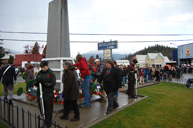 A long line of citizens await their turn to approach the Cenotaph and lay their own wreaths. David F. Rooney photo