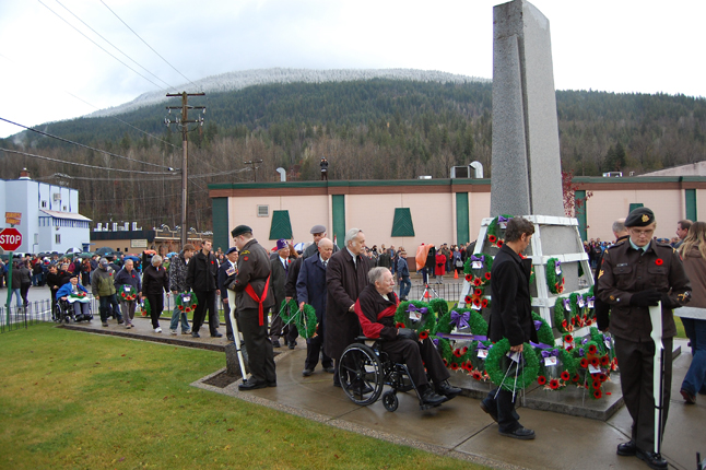 Another view of Revelstokians approaching the Cenotaph. The people of this community truloy do take Remembrance Day to heart. David F. Rooney photo