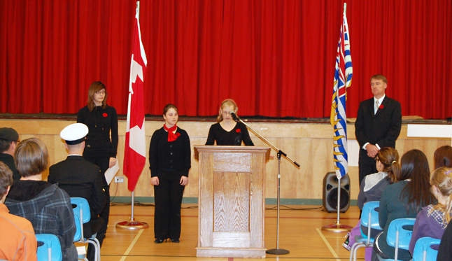 RSS Student Leadership Council members Corina Foisy, Charlotta Beglinger and Kennedy Healey talk to the student body at the start of RSS's own Remembrance Day ceremony on Tuesday. David F. Rooney photo