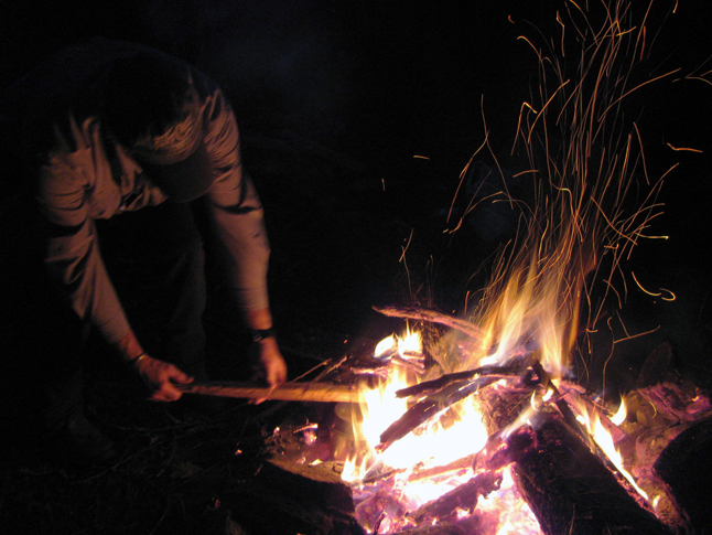 Karen Wahlstrom gets the fire roaring. Photo courtesy of Revelstoke SAR