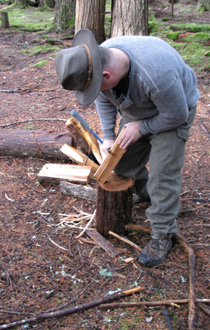 Greg Brule prepares wood to start a much-appreciated fire. Photo courtesy of Revelstoke SAR