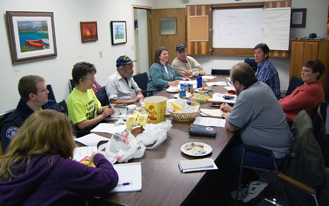 Members of the Shuswap Columbia District Labour Council talk about labour issues during their Thursday evening meeting in the boardroom of the Community Futures Development Corporation. David F. Rooney photo