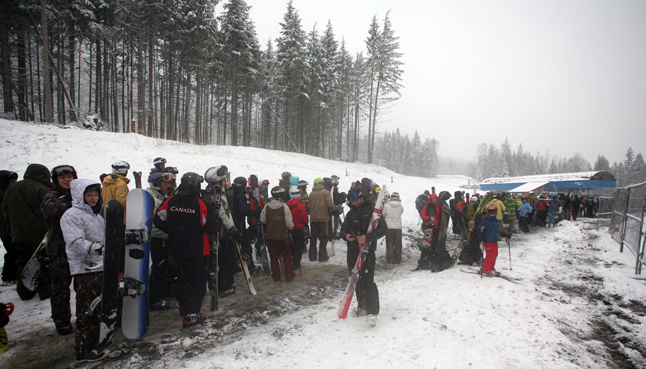 Skiers wait in line at the base of the mountain on Saturday. Some skiers tried to beat the rush by lining up at 5:30 am. The conditions on the upper mountain were worth the wait. Photo courtesy of Karilyn Kempton/Revelstoke Mountain Resort