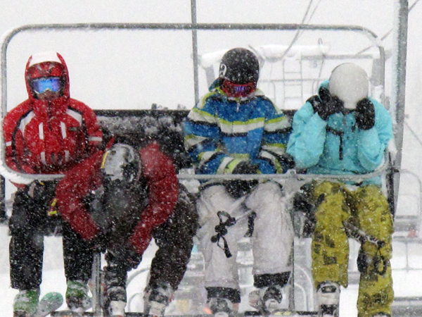 Of course, getting to the top meant getting a few flakes in your face, especially if, like these four boy, you were the very first people in line — at 5:30 am. Photo courtesy of Karilyn Kempton/Revelstoke Mountain Resort