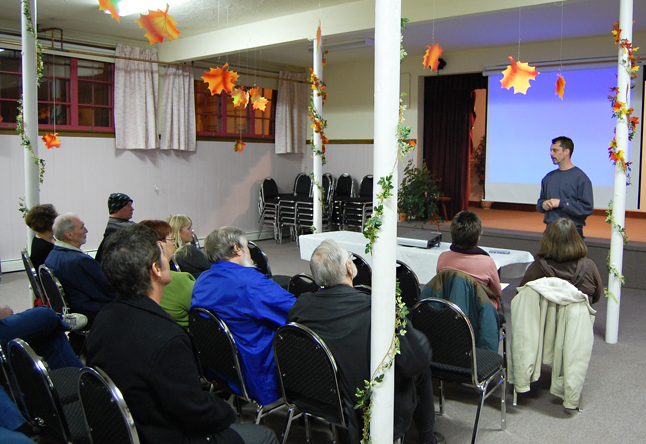 Documentary filmmaker Paul Manly (right, standing) talks to the people who turned out for the screening of his film, You, Me & the SPP, at the United Church Hall on Sunday evening. Manly's 90-minute film explores the little-known Security and Prosperity Partnership that some fear may further integrate Canada and the United States. The event was sponsored by the Shuswap Columbia District Labour Council and the Council of Canadians. David F. Rooney photo