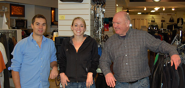 """Style Trend is under new ownership. The well-known local fashion store has been purchased by Steven Bull (left) and his wife, Diane Ottenbreit (center) from long-time owner Mark McKee. The three of them met at the store Monday for a quick photo. Ottenbreit says no changes are planned for the immediate future, although  she and Bull do plan to bring in more stock. As for McKee, he said that after very nearly 32 years it was time for the store to pass into the hands of """"people who are a little younger and little more energetic."""" But that doesn't mean the former mayor and BC Liberal candidate is going out to pasture. He has opened a new shop at 120 Connaught dedicated entirely to Telus services and products. David F. Rooney photo"""