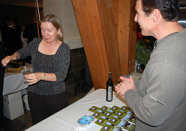 Tuulikki Tennant serves up some vino for friend and neighbour Lawrence Nagy.  David F. Rooney photo