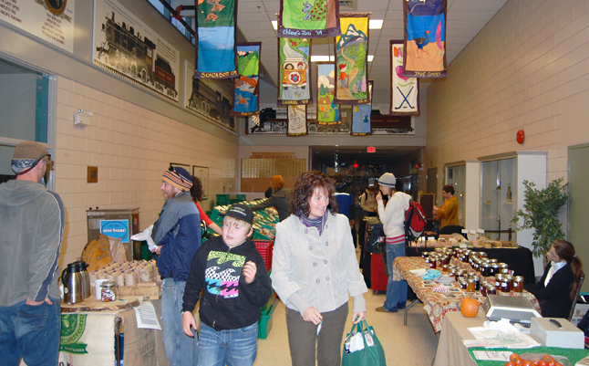 Shoppers browse through the stalls of the first Winter Farm and Craft Market at the Community Centre on Thursday. You can dinf all the dates and times the market will be open in the What's On This Week listings in The Current. David F. Rooney photo