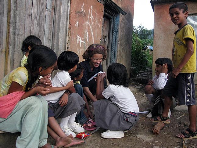 Laura Stovel talks with children in Pyuthan Okharot. Photo courtesy of Sradda Thapa