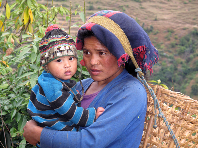 A Nepalese woman holds her child. Photo courtesy of Laura Stovel