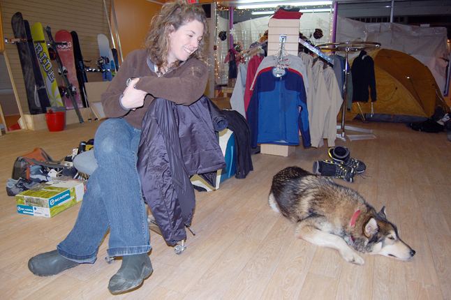 Anne-Marie Lefaivre smiles warmy at her dog Chimo as he snoozes away during an interview about her new business, Back On The Rack. She and her partner, Anne Morrison, are opening their shop for business on Saturday, Dec. 19. David F. Rooney photo