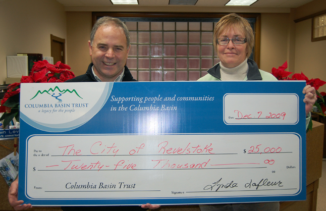 Mayor David Raven was all smiles at noon Monday when he took possession of a cheque for $25,000 from Lynda Lafleur, the Columbia Basin Trust's community liaison. The money will help finance development of a public participation strategy for the City, which it needs to to ensure that its ongoing development of new transportation, parks, and environmental strategies have broad and deep public input. David F. Rooney photo