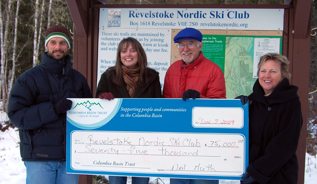 Grateful members of the Revelstoke Nordic Ski Club Board Kevin Bollefer (left) Karen Bray and Keith McNab were exceptionally happy to receive a cheque for $75,000 from Columbia Basin Trust director Loni Parker on Monday afternoon. The club has great plans for the money. It will be used to help build a permanent, year-round cabin at the base of Mount Macpherson as well as an expanded trail system. The club recently received, thanks in part to backing from the City, $125,000 in Economic Opportunity Fund money for the project. David F. Rooney photo