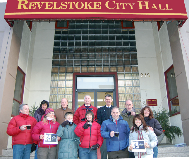 Revelstoke is Canada's latest community to win official Fair Trade Town status. Members of the Revelstoke Fair Trade Committee got together on the steps of City Hall with Mayor David Raven and City Councillors for a cup of Fair Trade java and an official photo op. From left to right, starting in the front, are: Corin Flood, Josee Zimanyi, Councillor Antoinette Halberstadt, Mary Clayton, Mayor David Raven and Lisa Canicilla-Sykes, Behind them, form left to right, are: Shirley Berg, Revelstoke's Chief Administrative Officer Ross McPhee and Councillors Phil Welock, Peter Frew and Chris Johnston. After a quick 10 or so frames, the group returned to Council Chambers where Knight read a letter, which is reproduced below, on behalf of the committee. David F. Rooney photo