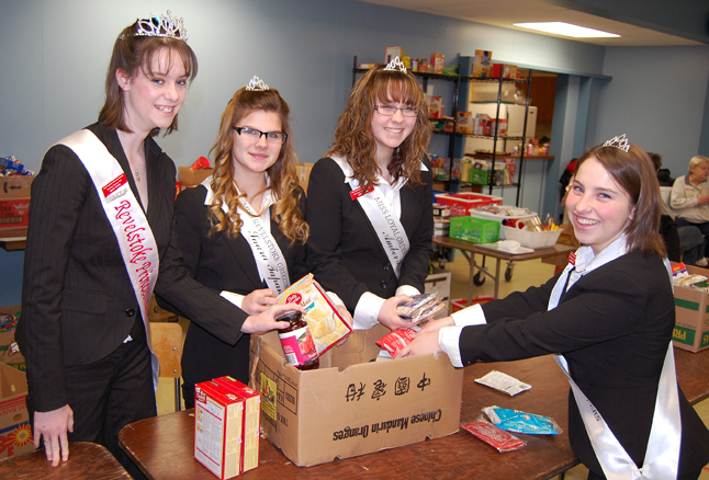 Christmas generosity doesn't always mean giving gifts or donations. Time and effort, too, are important contributions and these four lovely young ladies — (from left to right) Miss Revelstoke Princess Diane Young, Miss Revelstoke Grizzlies Saara Pacanainea, Miss Loyal Order of the Moose Amber Hart and Miss Revelstoke Crime Stoppers Karina Foisy — certainly contributed both to the Food Bank on Saturday. These four members of the Revelstoke Ambassador program put in a full morning packing hampers. David F. Rooney photo