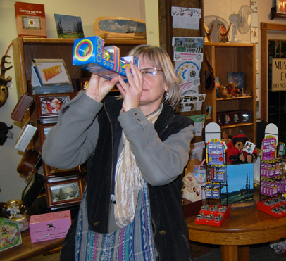 Sue Leach gazes into a psychedelic kaleidoscope in the gift shop at the Nickelodeon Museum. David F. Rooney photo