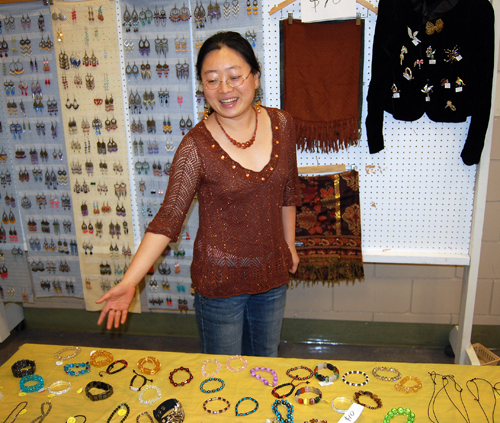 Yan Liu shows off some of her hand-made jewellery at the No Host Bazaar on Sunday. The 34-year-old from northern China is ambitious and hopes to build a better life here in Revelstoke. David F. Rooney photo