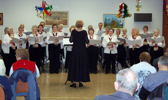 The Selkirk Singers raised their voices in song during a concert at the Revelstoke Seniors' Centre Friday evening. Led by conductor Charlene Robertson, the choral group — formerly known as the Seniors' Choir — is busy reinventing itself. David F. Rooney photo