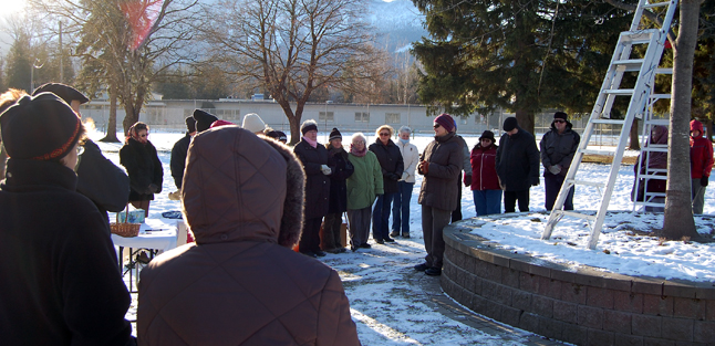 Vivian Mitchell speaks to the crowd of about 50 people who turned out for the Revelstoke Hospice Society's annual Snowflake Ceremony at Queen Elizabeth Park on Sunday. David F. Rooney photo