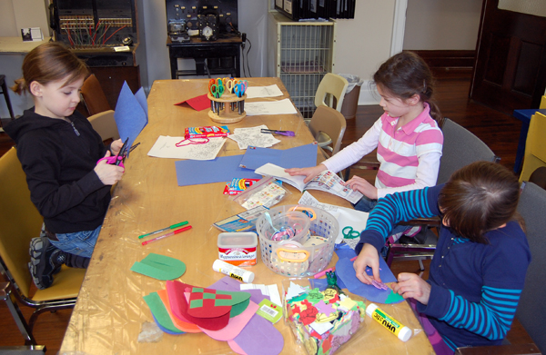 These three young ladies were busy making very creative original Christmas cards for their families. David F. Rooney photo