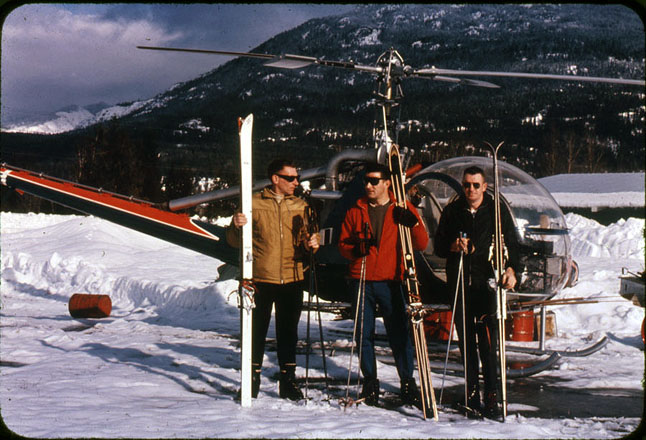Left to Right:  Karl Hoeller, Len Cerolini and Ken Murphy, Feb. 11, 1964, before leaving for a heli-skiing trip on Mount Macpherson.  They took about four hours to ski down to the highway. Colour slide by Estelle Dickey courtesy of the Revelstoke Museum & Archives