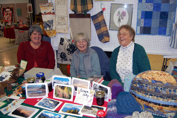 """Artists Jutta Maraun, Inge Anhorn and Lorna Duncan share joke at the market. """"We're the Three Musketeers,"""" Duncan chuckled. David F. Rooney photo"""