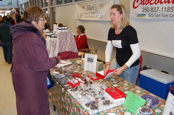 Carol Sakamoto purchases some chocolatey Christmas treats from Chocolate Summit's Wendy Mulligan. David F. Rooney photo
