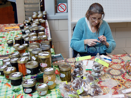 Janice Jarvis knits during a lull in the Farmers' Market. David F. Rooney photo