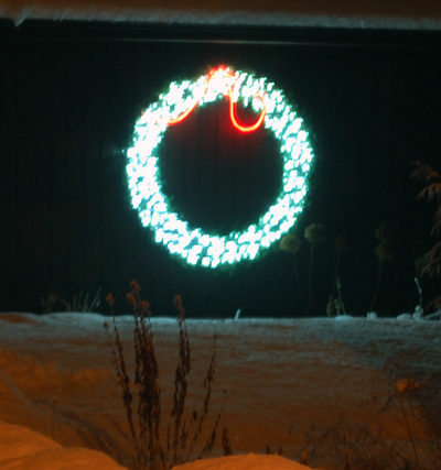 More than a few houses in town sport just one decoration. Sometimes it's simply a string of lights along the gutter or, as in this case, a glowing wreath of lights.  David F. Rooney photo