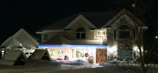 Lights gleam on this home directly across from Kovachs Park.  David F. Rooney photo