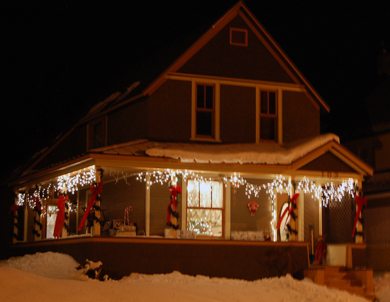 Not every house that is decorated is done so with lots of light. This house on Third Street East has some lights, but what I particularly liked were the winding evergreen bows on the pillars and the streaming red-fabric bows.  David F. Rooney photo
