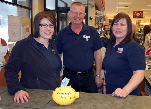 """Kirstin Larson, Jim Holdener and Kerrie Lentini pose with one of the piggy banks Carol Sakamoto has put out for the Mitts for Kids Program. """"Will you donate coins to buy mitts, scarves and hats for Revelstoke families in need?"""" she asks. These folks jumped in with $5. You can help, too. """"The Thrift Shop has some mitts for just $2 and the Piggy Banks and Christmas Bags are found in stores near you,"""" Sakamoto says. """"This campaign will continue for the winter."""" You can also take a donation to the Food Bank or call Sakamoto at 250-837-4396 for delivery. David F. Rooney photo"""