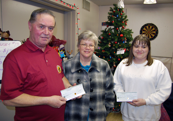 The Loyal Order of the Moose was very generous to the Community Connections Food Bank this year. Dave Kruger (left) presented Patti Larson with a cheque for $1,500 raised through the Moose Lodge's regular bingo games while Moose member Cindy Cota (right presented her with a $1,000 cheque for the annual Christmas Hamper Program on Tuesday evening. David F. Rooney photo