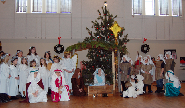 The entire cast of the St. Francis of Assisi's children's Nativity pageant. David F. Rooney photo