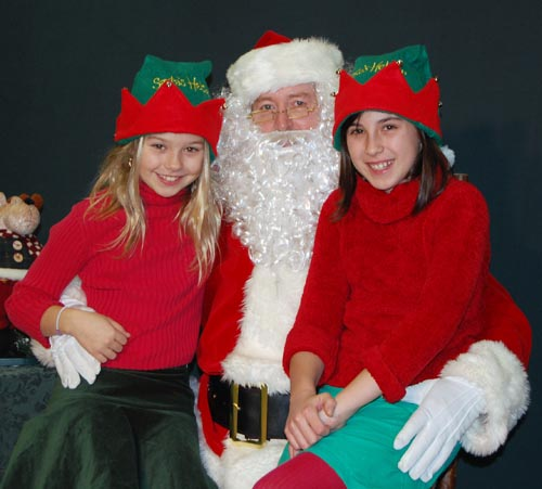 Santa Claus poses with two of top helpers, Lainey Thur and Sammy Legebokow, at the Revelstoke & District Humane Society's annual Pose Your Pet With Santa fundraiser at the Senior's Centre on Saturday. Ninety-five people dropped by with their pets, and their kids, to meet Santa. David F. Rooney photo