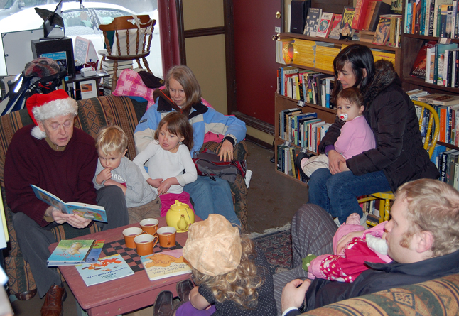 Whether he's on stage or posing as one Santa's elves, Peter Waters knows how to captivate an audience, even a really young one. Here he is reading stories to youngsters at Castle Joe Books on Thursday. David F. Rooney photo