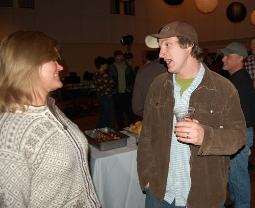 Rob Buchanan (right) talks with visiting ski writer Monica Andreeff.  David F. Rooney photo