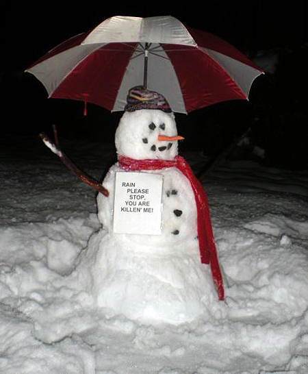 """Portrait of a desperate snowman """"With all the rain in the past fews days our family had to resort to some serious measures,"""" said Teresa Meyaard in an e-mail to The Current. """"Save Our Snowman! His name is Forest Drive... and also our street address! Please print it, it you wish! Great Job with The Current It's awesome!"""" Why, thanks for the compliment, Teresa. Photo courtesy of Teresa Meyaard"""