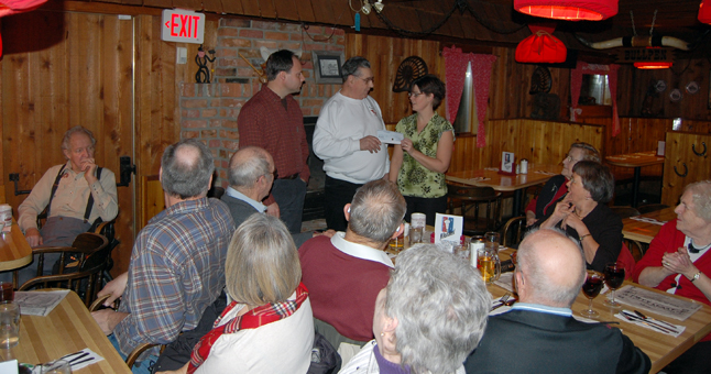 As fellow Elks look on, Elks Lodge president Clancy Boettger (center) hands a cheque for $2,030 to Catherine Bellerose who organized, along with Gregg Walker (left, beside Boettger), last Saturday's benefit evening for Pauline Hunt, the local woman who was recently diagnosed with Amyotrophic Lateral Sclerosis (ALS), also known as Lou Gehrig's disease. The cheque represented all of the money that the Elks made when they manned the cash bar for the event. The lodge is one of the city;'s most active fund-raisers. Among other donations in the last year they gave $8,000 to the City for new playground equipment at Queen Elizabeth Park and $3,400 to Queen Elizabeth Hospital for tonsil-extraction equipment. Bellerose was very appreciative of the lodge's generosity and told them that the silent auction raised more than $12,000 to help Pauline and her husband Simon take their two young daughters on some adventures that will help build the kind of happy memories they will need as the incurable disease progresses and life becomes much tougher for them. David F. Rooney photo