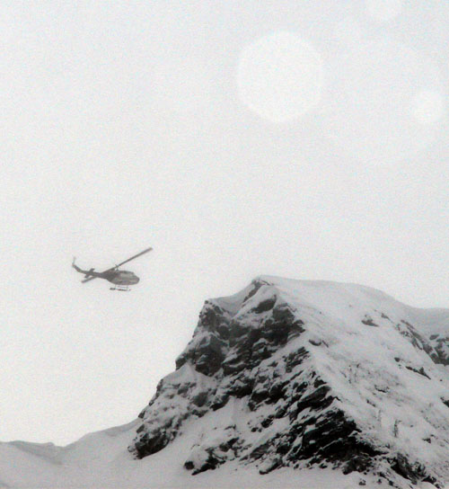 A Selkirk Tangiers helicopter drops competitors on the ridge above Mackenzie face. Karen McColl photo