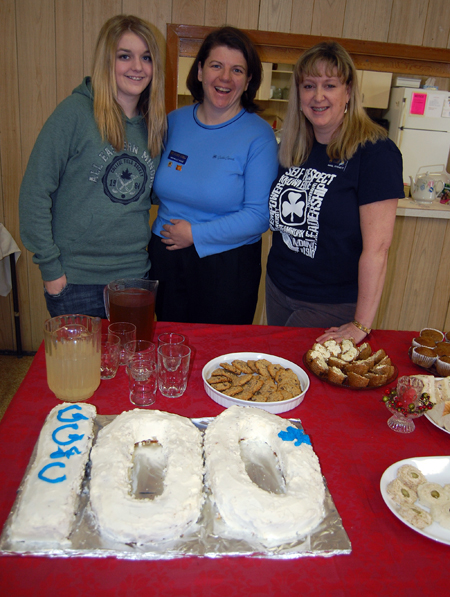 Riley Johnson, Michelle Cole and Carol Fitchett pose with the cake that was baked to commemorate 100 years of Girl Guides. The movement began in the United Kingdom in 1910 and spread to Canada, reaching Revelstoke in 1923. There currently are about 60 Sparks, Brownies, Guides and Pathfinders in Revelstoke. David F. Rooney photo