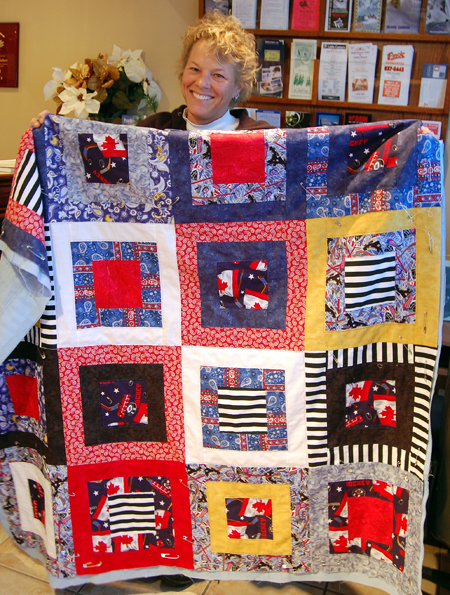 Suzie Cameron shows off the quilt she has made as a fund-raiser for the Revelstoke Hockeyville Committee. The Committee is planning a draw for this lovely work. Details will be announced as they become available. David F. Rooney photo