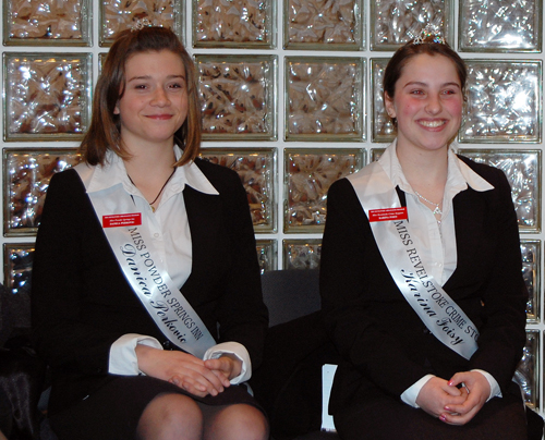 Ambassadors Danica Perkovic (left), who is Miss Powder Springs, and Karina Foisy, Miss Revelstoke Crime Stoppers, brightened up last Tuesday's Council meeting with their sunny demeanor. David F. Rooney photo