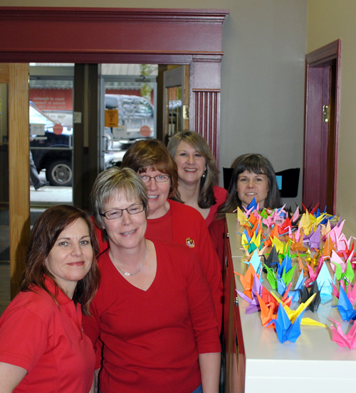 he RESC ladies — Cathy Burke, Krista Stovel, Annie Wilson, Otti Brown and Cathie Thacker — showing off the cranes they have folded for the 1910 Memorial event taking place in March. They think they have made the most cranes in town... is that true? Karen McColl photo