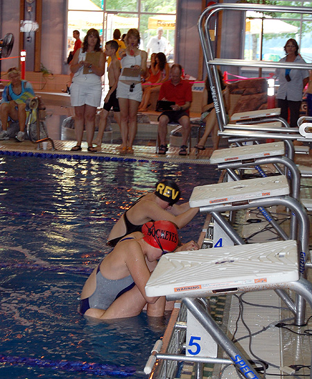 """Emily Pfeiffer (centre in the black-and-yellow cap) waits for the """"Go"""" signal in a backstroke final on Sunday. David F. Rooney photo"""