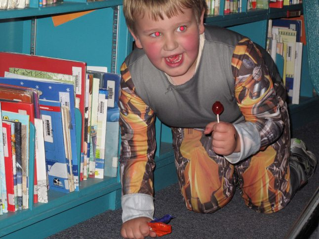 Transformer Caleb Andrews emerges victorious from a maze in the Mountain View library. Laura Stovel photo
