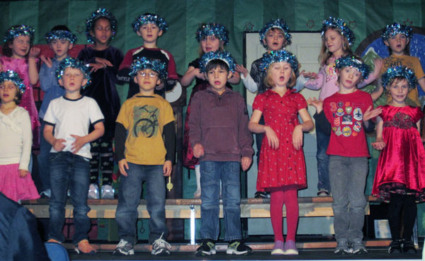 Ms. Stribrny's Grade One class performs their song called Let's Get The Story Straight in The Story Book Christmas Production at Arrow Heights Elementary School.  Photo by Julian Corbett, caption by Griffin Velichko