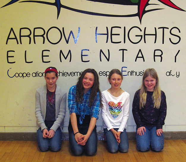 And here are the top spellers! (Left to Right) Zoe Kramer, Alana Brittin, Emily MacLeod, and Amelia Brown.  Amelia came in first at the AHE Bee.  Zoe, Alana and Emily will join her at the district bee that will be held on February 26 with Columbia Park Elementary and Begbie View Elementary Schools.  We wish them luck! Photo and caption by Julian Corbett