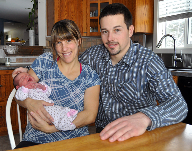 Meet Revelstoke's newest citizen: Miss Anika Raasch posing here with her parents Marie-Claude de Launiere and Quintin Raasch. Anika was born just two days ago at on January 2 at 6:55 pm at Queen Victoria Hospital. David F. Rooney photo